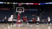Desi Rodriguez rises to block the shot