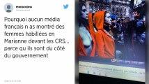 Drôle de face-à-face sur les Champs-Élysées entre forces de l'ordre et Marianne aux seins nus