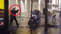 French policeman pulls gun on protesters
