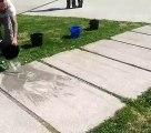 Water Art : il jette de l'eau sur des dalles pour voir des oeuvres d'art