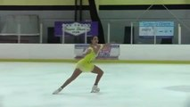 Figure Skater Does Two Spinning Jumps During Routine