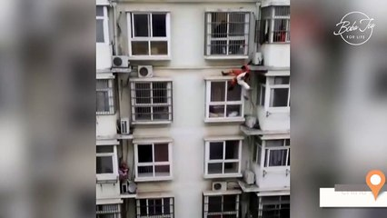 Fireman risks his life to save woman from suicide attempt in China