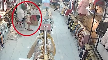 Security camera recorded a female shoplifter disguising herself as customer to outwit staff