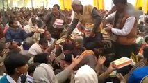 Liquor inside food packets distributed at temple event by BJP leader