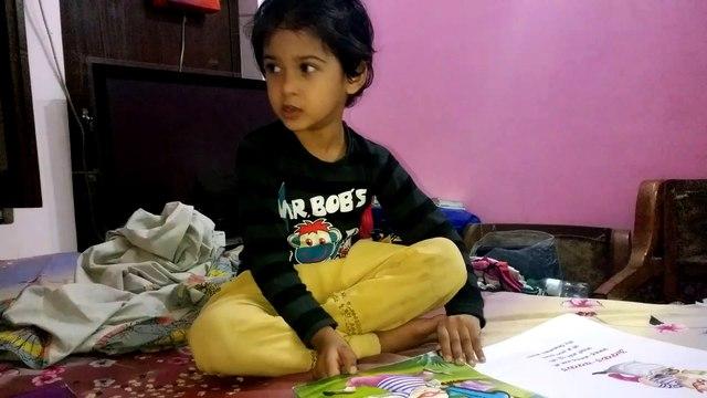 A cute little girl singing nursery rhymes