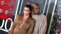 Kim Kardashian and Kanye West are 'closer' with a baby on the way