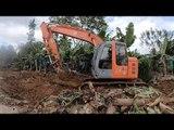 Excavator Works On Banana Plantation Canal / Constructing A Stadium