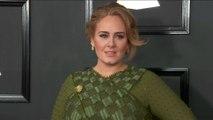 Adele spotted on date night at Elton John gig