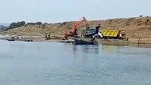 Sand excavation by machines near Narmada bank