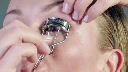 putting on false eyelashes