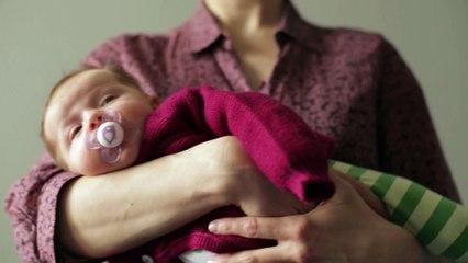 Pflege & Ausstattung - Baby 1x1: So bindest Du eine Kreuzbauchtrage