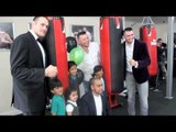 TYSON FURY & HUGHIE FURY POSE FOR PICTURES WITH SOME YOUNG FURY FANS IN BOLTON