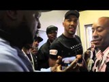 KEVIN JOHNSON BANTERS WITH ANTHONY JOSHUA IN THE CORRIDOR AS PAIR MEET AFTER WEIGH-IN .