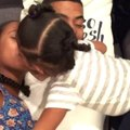 Little Girl Gives Parents Head-Butting Kisses