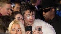 Actor Ezra Miller Stuns In Red Lip Stick At Paris Fashion Week