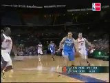 Emeka Okafor challenges Linas Kleiza on the break and sends