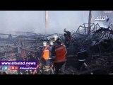 صدى البلد | محاولات السيطرة على حريق موبيكا بطريق اسكندرية الصحراوى