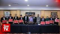 Six Sabah reps who jumped from Umno get Bersatu cards