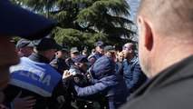 Albanian riot police clash with protesters calling for early elections
