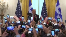 Donald Trump throws 'Make Greece Great Again' hat into crowd