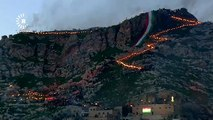 Watch: Iraqi Kurds celebrate Nowruz with torchlit mountain procession