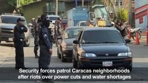 Police patrols after riots erupt in Caracas amid power rationing