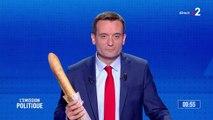 """Florian Philippot, tête de liste pour Les Patriotes, présente une baguette de pain, symbole de l' """"augmentation forte des prix du passage à l'euro"""""""