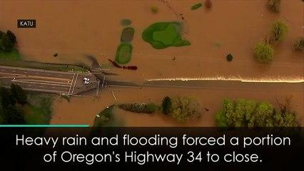 Speedboat zooms along flooded Oregon highway
