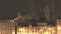 Fire burns through Paris' historic Notre Dame Cathedral