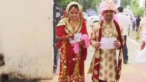 Lok Sabha Elections 2019: Newly-married couple turn up for voting in J&K's Udhampur   Oneindia News