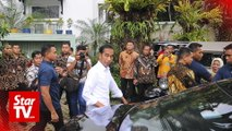Joko Widodo urges supporters to wait for official election results in May