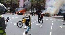 Encore une voiture qui prend feu devant le palais