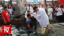 30 people baptised on Easter Vigil in Sibu