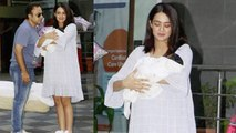 Surveen Chawla smiles with baby girl outside Hospital; Watch video   FilmiBeat