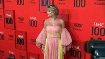 Rami Malek and Brie Larson walk the Time 100 red carpet