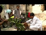 Children feeding sacrificial goat on the occasion of Eid al-Adha