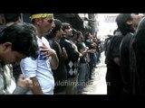 Muslim men singing and self beating on the Mourning of Muharram