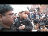 Shiite Muslims flagellate themselve with chains during  Muharram
