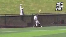 College baseball player leaps over fence for epic catch
