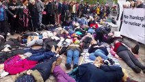 CND activists stage die-in protest outside Westminster Abbey in London