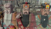 Giant gods stand guard over Chinese building in Beijing suburb