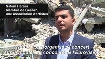 Un groupe à Gaza proteste l'Eurovision sur les ruines d'un immeuble