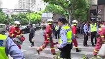 Shanghai: recherches sur le site de l'effondrement d'un immeuble