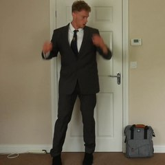 Putting on a suit.