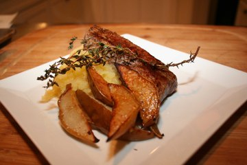 Steak with Smashed Rutabagas and Roasted Pears