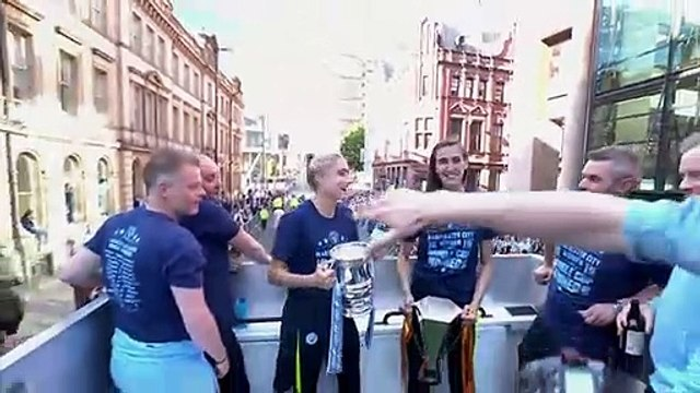 Manchester City celebrate their historic treble trophy success