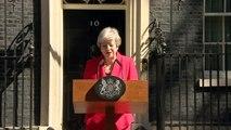 Tearful Theresa May announces resignation