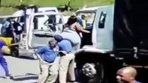 Ils utilisent un trans-palette pour installer une femme obèse dans un camion