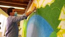 Le maire de Remiremont  en train de peindre à la bombe un mur de la maison de retraite Léon-Werth
