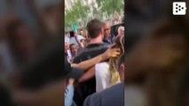 A fan kisses Miley Cyrus in Barcelona